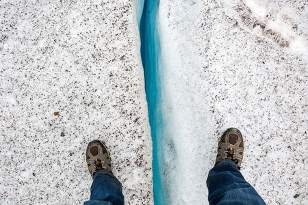 Standing over a crevice