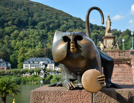 Metal Monky statue at the river and bridge in Heidelberg in the sun Stock Photo