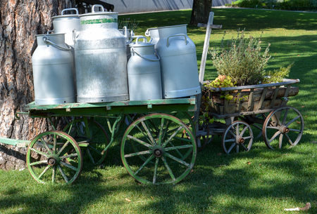 Several old milk churns on a wagon at the Gurten in Bern in the sun