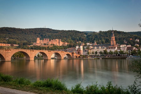 The Heidelberg castle and Carl Theodor bridge with smooth water
