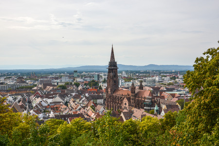 The old town and cathedral of Freiburg, Germany from a hill