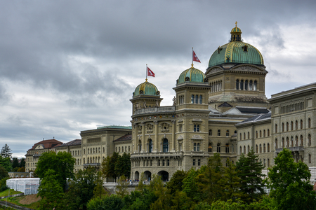 The impressive Bundeshaus in Bern, Switzerland with a cloudy sky