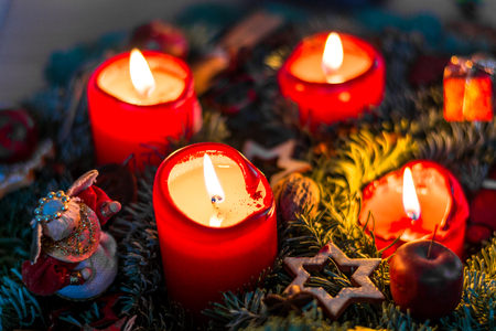 Advent wreath with lit red candles from above Stock Photo