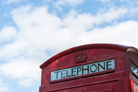 old english: An old red british telephone booth as a close up
