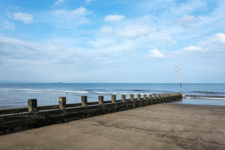 groynes: Portobello beach with groynes and the sea and clouds above