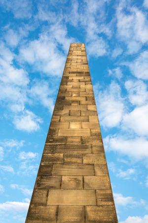 Obelisk on the Old Calton Burial Ground in Edinburgh, Scotland with blue sky