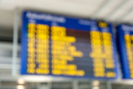 A blurry arrivals sign at the airport close up