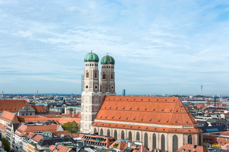 Aerial view on Frauenkirche and city center near Marienplatz in Munich, Germany with blue sky