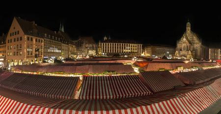 NUREMBERG, GERMANY - December 7th, 2017: Panorama of the lit Christmas market in Nuremberg at night