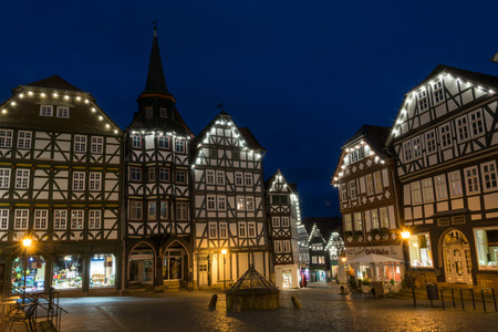 FRITZLAR, GERMANY: 25th December 2017: The marketplace of Fritzlar with fountain and fairy lights during blue hour Editorial