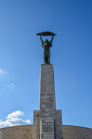 Liberty statue near the citadel on Gellert Hill with blue sky Stock Photo