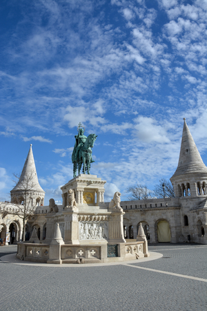 Szent Istvan statue at Fishermans bastion in Budapest with blue sky Stock Photo