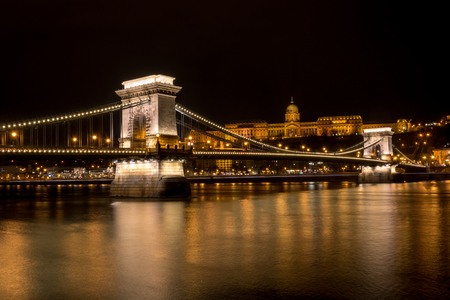 The Chain Bridge over the river Danube with the Royal Palace in the background in Budapest at night Stock Photo