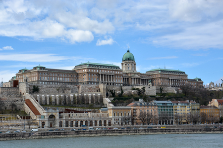 The Royal Palace at the river Danube in Budapest with blue sky Editorial