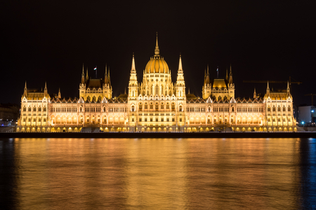 The famous Budapest parliament at the river Danube at night from the front Stock Photo
