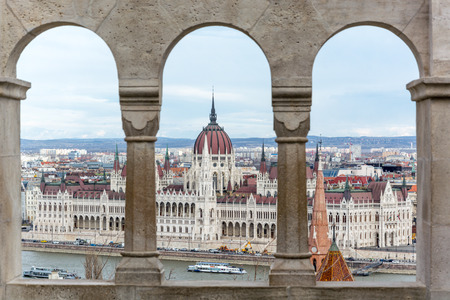 Budapest parliament seen from Fishermans bastion through pillars