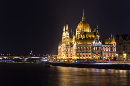 The famous Budapest parliament at the river Danube at night from the side