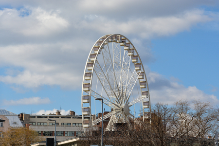 Big wheel in the city center of Budapest with blue sky