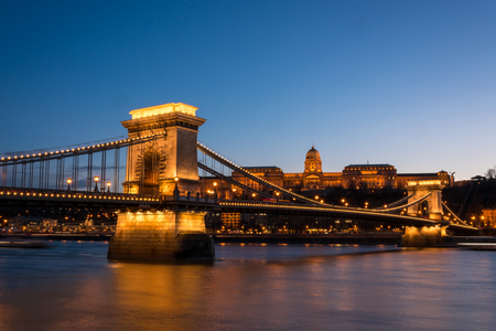 The Chain Bridge with the Royal Palace in the background in Budapest during the blue hour