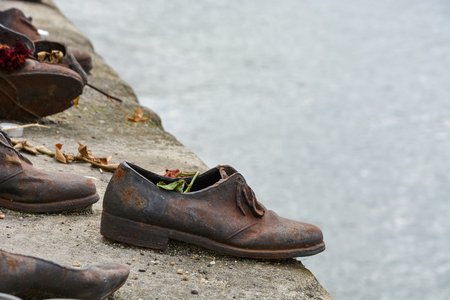 Iron shoes at river Danube in memory of the excecuted Jews in Budapest, Hungary Stock Photo