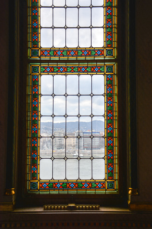 Beautiful windows with cigar holders below in the Budapest parliament, Hungary Stock Photo