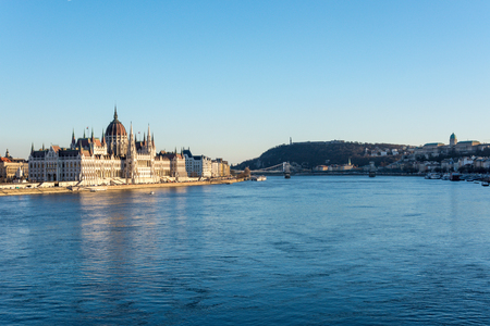 The Budapest parliament and Chain Bridge and palace at the river Danube during sunset from the side