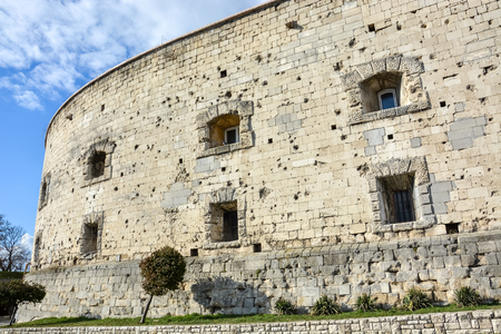 Bullet holes in the stone wall of the citadel in Budapest with blue sky