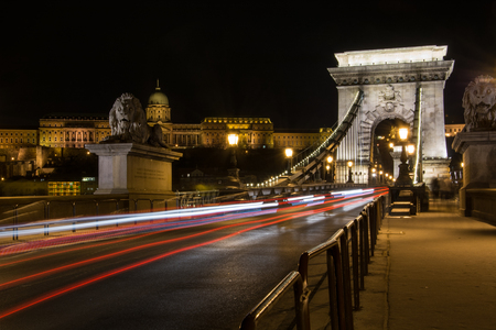 The Chain Bridge with the Royal Palace in the background and traffic light trails in Budapest at night