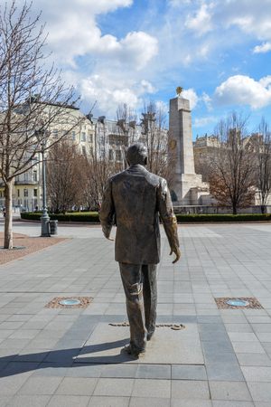 The Ronald Reagan statue with the US embassy and the Soviet war memorial in Budapest Stock Photo