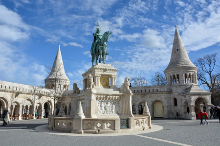 Szent Istvan statue at Fishermans bastion in Budapest with blue sky Editorial
