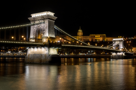 The Chain Bridge over the river Danube with the Royal Palace in the background in Budapest at night Editorial