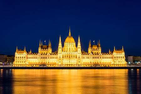 The famous Budapest parliament at the river Danube during blue hour from the front Stock Photo