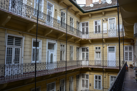 Historical courtyard with balconies in Budapest, Hungary