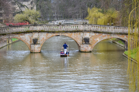 Punting on the river Cam in Cambridge, England with cloudy sky 写真素材