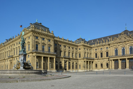 Fountain in front of the Wuerzburg residence on a sunny day and blue sky