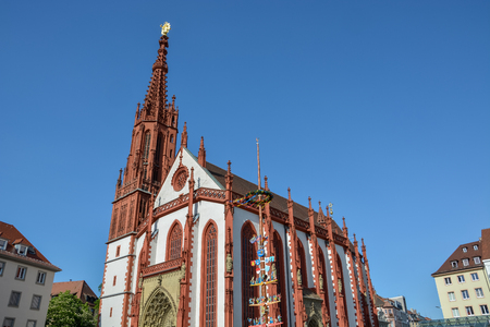 The iconic red Marien chapel at the market square in Wuerzburg on a sunny day and blue sky