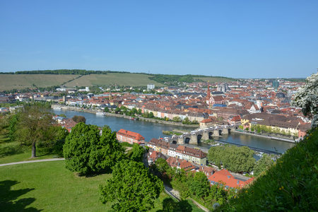 Aerial view on Wuerzburg with the alte Mainbruecke and the Marien chapel on a sunny day and blue sky