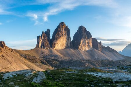 The famous mountains Three Peaks in the Dolomites during sunset