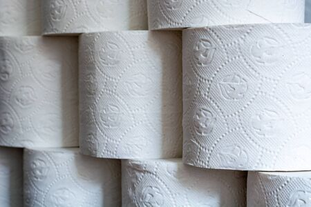 Piled up toilet paper rolls as a close up from the side 스톡 콘텐츠