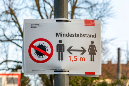 NUERNBERG, GERMANY - March 27, 2020: Sign in German about keeping a minimum of 1.5m distance due to the Corona Virus Editorial