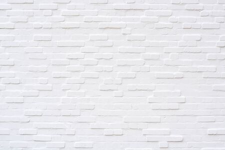 An empty white brick wall from the front