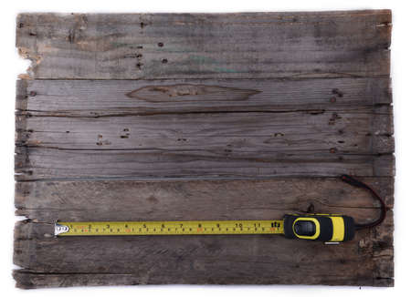hardware repair: Measuring tape on wooden background Stock Photo