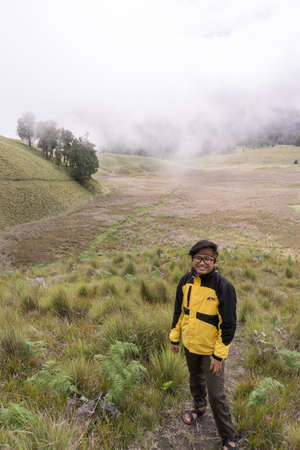 young man in semeru savana