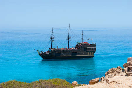Black pirate ship on the blue sea