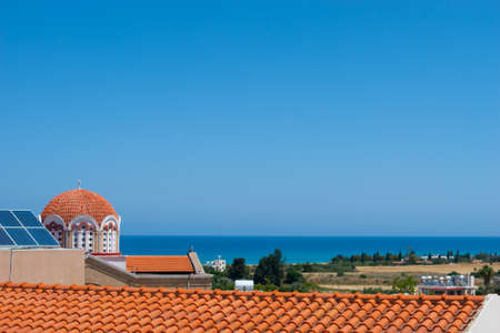 View on the red roof, temple and blue sea in Polis city Stock Photo