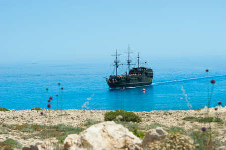 Pirate ship on the sea. Front view