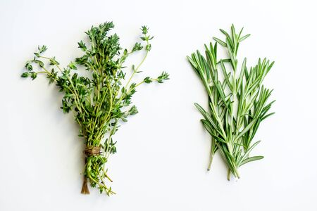 Bunches of tied thyme and rosemary on white background isolated Stock Photo