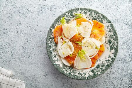 Fresh salad with red orange and fennel on textured background