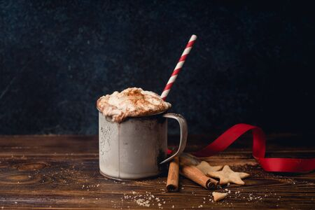 Hot chocolate with whipped cream, cinnamon and cookies. Winter warming comfort drink concept Stock Photo