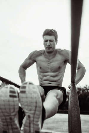 pushed: sport day guy pushed his torso on the site free outdoor summer Stock Photo